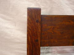 Detail of the pinned mortise and tenon construction of the back of the settle.