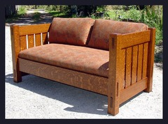 Same form shown in the smaller size with fabric cushions in a medium nut brown finish.  We have a large selection of the finest Arts and Crafts quality fabrics or the customer can supply their own fabric. Please see settle model # 230M