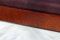 View of fine quarter sawed white oak wood grain in the front seat rail, as throughout.