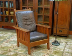 L J G Stickley vintage Morris chair with slats to the seat.