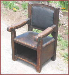 Arts and Crafts period arm chair.