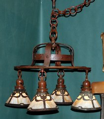 Arts and Crafts hammered copper Handel chandelier with slag glass tulip design shades.