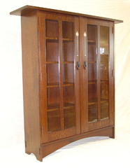 Gustav Stickley Harvey Ellis inspired two door bookcase with inlaid doors.