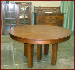 L. & J. G .Stickley 54in. Oak Dining Table with Four Leaves