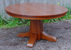 Gustav Stickley 54 inch pedestal dining table with 4 leaves, signed.