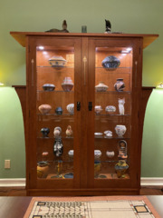 Custom two door inlaid cherry china display cabinet with adjustable glass shelves and remote light controls.