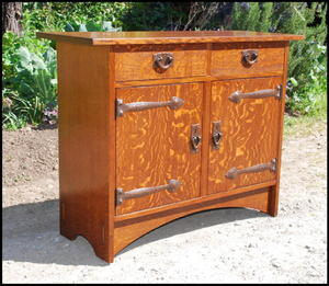 Gustav Stickley inspired custom two door cabinet  with two drawers and hammered copper strap hinges.