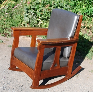 Charles Limbert large rocker with back cushion & heart cut out design in a single slat under each arm.
