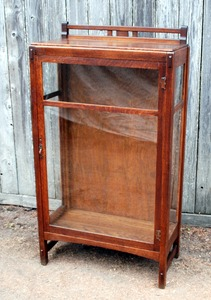 Charles Limbert single door china cabinet.