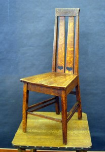Stickley Brothers early desk chair with heart cut out design and tapered legs.