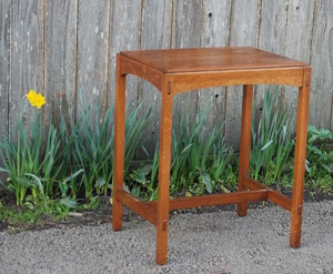 Limbert lamp  or console table with arched rails and pinned thru tenons, signed with brand