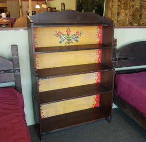 Rare Monterey painted open bookcase in dark finish