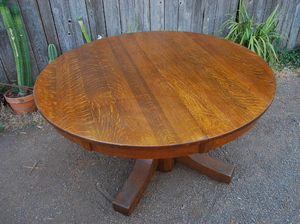 Stickley Brothers 54 in dining table with 5 leaves, two with aprons.  Signed.