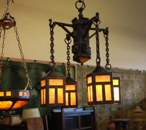Arts and Crafts  Monks Head Chandelier. Circa 1908. Stickley era.