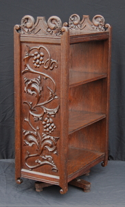 English Arts and Crafts revolving carved oak bookcase.  Grapevine design.
