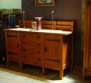 Gustav Stickley vintage eight leg sideboard with hand hammered copper hardware.  Double signed.