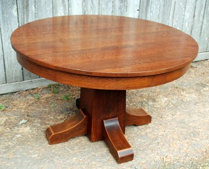 Original L. & J. G. Stickley 42 inch dining table with 4 original leaves, signed.